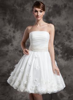 A-Line/Princess Strapless Knee-Length Organza Wedding Dress With Ruffle Beading Flower(s)
