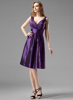 A-Line/Princess V-neck Knee-Length Taffeta Bridesmaid Dress With Ruffle