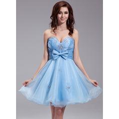 A-Line/Princess Sweetheart Knee-Length Organza Homecoming Dress With Ruffle Beading Bow(s)
