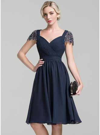 A-Line/Princess Sweetheart Knee-Length Chiffon Mother of the Bride Dress With Ruffle Beading Sequins